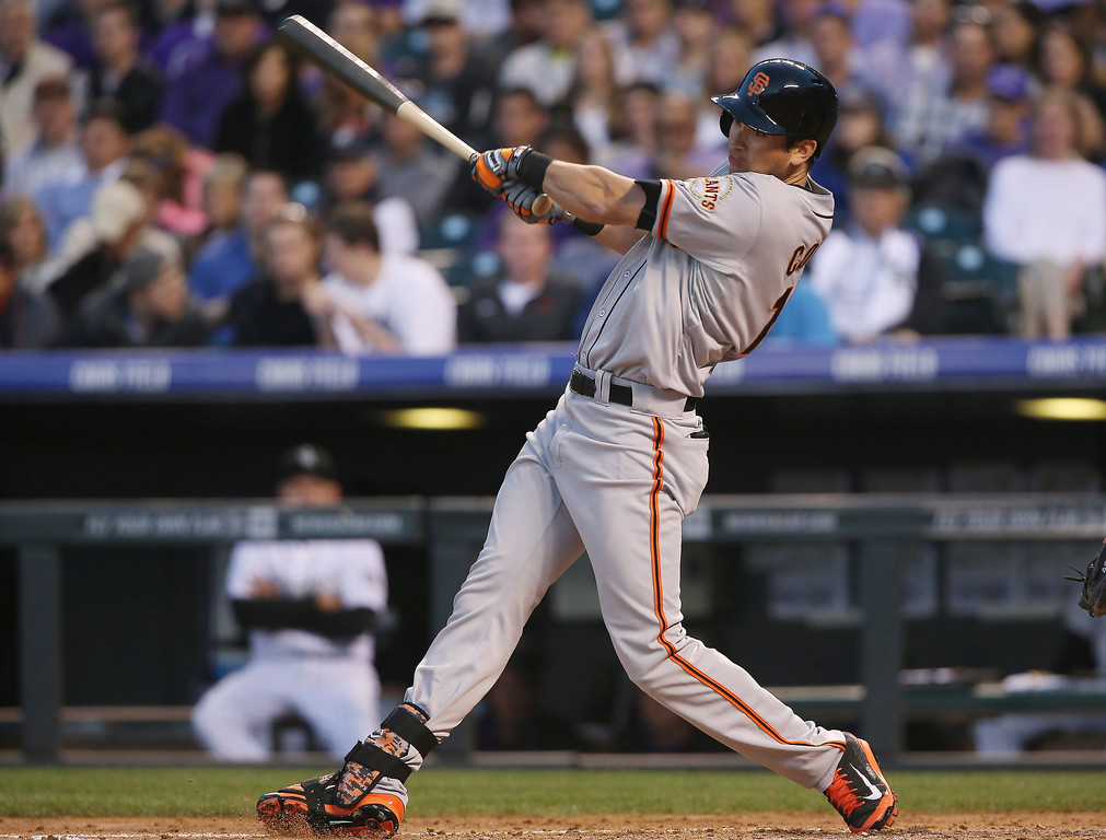 . San Francisco Giants\' Tyler Colvin doubles against the Colorado Rockies in the fifth inning of a baseball game in Denver on Tuesday, May 20, 2014. (AP Photo/David Zalubowski)
