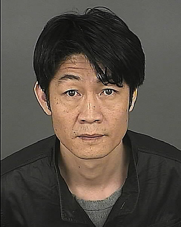. Fuyan Li (D.O.B. 10-8-1968) One of three men charged with allegedly trying to sell a woman fake gold.