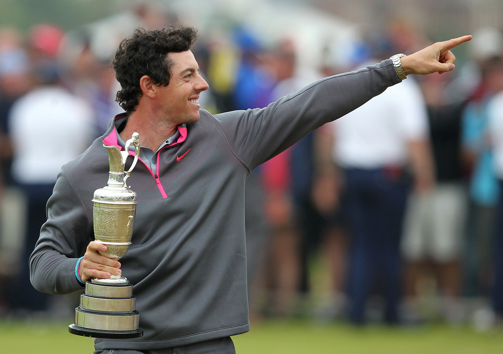 . Northern Ireland\'s Rory McIlroy gestures as he holds the Claret Jug as his poses for a photograph after winning the 2014 British Open Golf Championship at Royal Liverpool Golf Course in Hoylake, north west England on July 20, 2014. McIlroy won the British Open at Royal Liverpool Golf Course in Hoylake with a final round of 71. The 25-year-old Northern Irishman won with a seventeen under par total of 271, two strokes clear of Rickie Fowler and Sergio Garcia. PETER MUHLY/AFP/Getty Images
