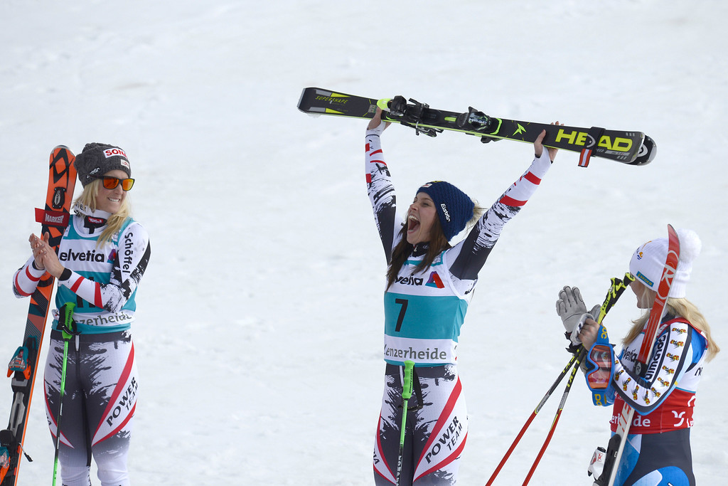 . Austria\'s Eva-Maria Brem, second placed, winner Austria\'s Anna Fenninger and Sweden\'s Jessica Lindell-Vikarby, third placed, from left, celebrate after the women\'s giant slalom race at the alpine skiing World Cup finals in Lenzerheide, Switzerland, Sunday, March 16, 2014. (AP Photo/Keystone, Jean-Christophe Bott)