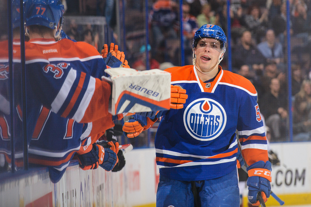 . David Perron #57 of the Edmonton Oilers celebrates after scoring against the Colorado Avalanche during an NHL game at Rexall Place on April 8, 2014 in Edmonton, Alberta, Canada. (Photo by Derek Leung/Getty Images)