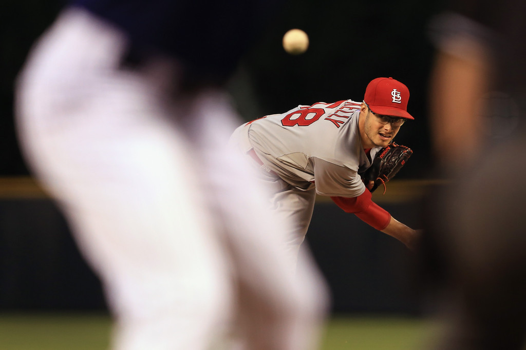 . Starting pitcher Joe Kelly #58 of the St. Louis Cardinals delivers against the Colorado Rockies at Coors Field on September 17, 2013 in Denver, Colorado.  (Photo by Doug Pensinger/Getty Images)