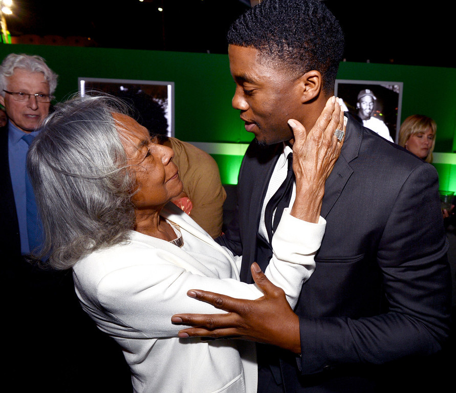 ". Jackie Robinson\'s widow Rachel Robinson (L) actor Chadwick Boseman appear at the after party for the premiere of Warner Bros. Pictures\' and Legendary Pictures\' ""42\"" at the Chinese Theatre on April 9, 2013 in Los Angeles, California.  (Photo by Kevin Winter/Getty Images)"