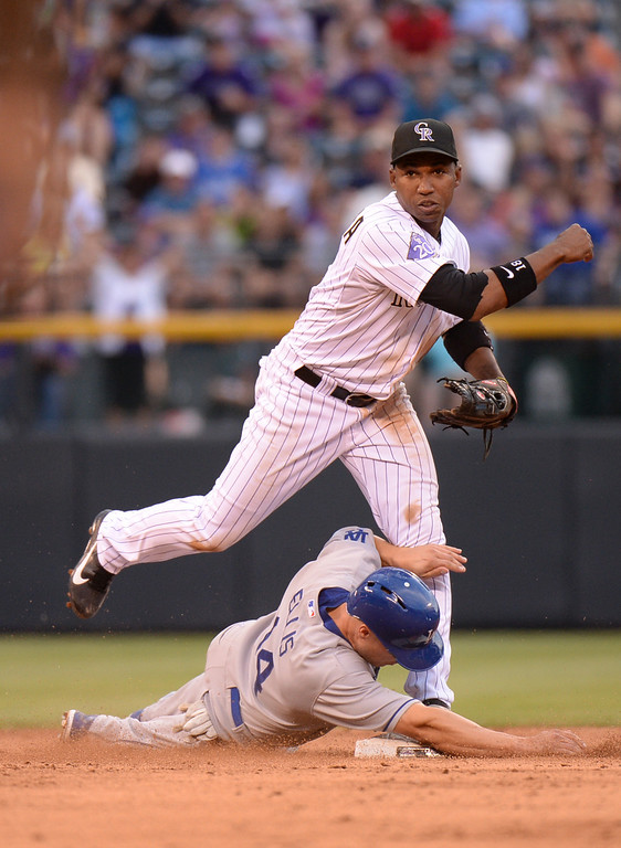 . DENVER, CO. - July 03: Jonathan Herrera of Colorado Rockies (18) tag Mark Ellis of Los Angeles Dodgers (14) and throw the ball to 1st base for double play at Coors Field. Denver, Colorado. July 3, 2013. (Photo By Hyoung Chang/The Denver Post)