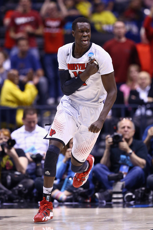 . Mangok Mathiang #12 of the Louisville Cardinals reacts after points in the first half against the Kentucky Wildcats during the regional semifinal of the 2014 NCAA Men\'s Basketball Tournament at Lucas Oil Stadium on March 28, 2014 in Indianapolis, Indiana.  (Photo by Andy Lyons/Getty Images)