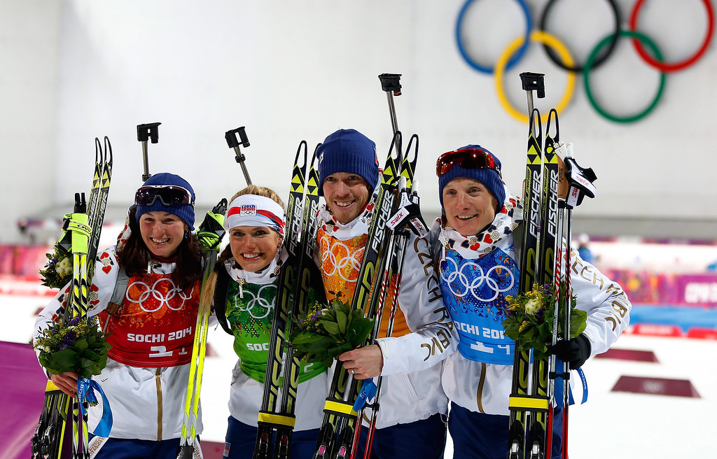 . (L-R) Czech Republic team Veronika Vitkova, Gabriela Soukalova, Jaroslav Soukup and Ondrej Moravec  celebrate on the flower podium after the Mixed Relay competition at the Laura Cross Biathlon Center during the Sochi 2014 Olympic Games, Krasnaya Polyana, Russia, 19 February 2014.  EPA/VALDRIN XHEMAJ