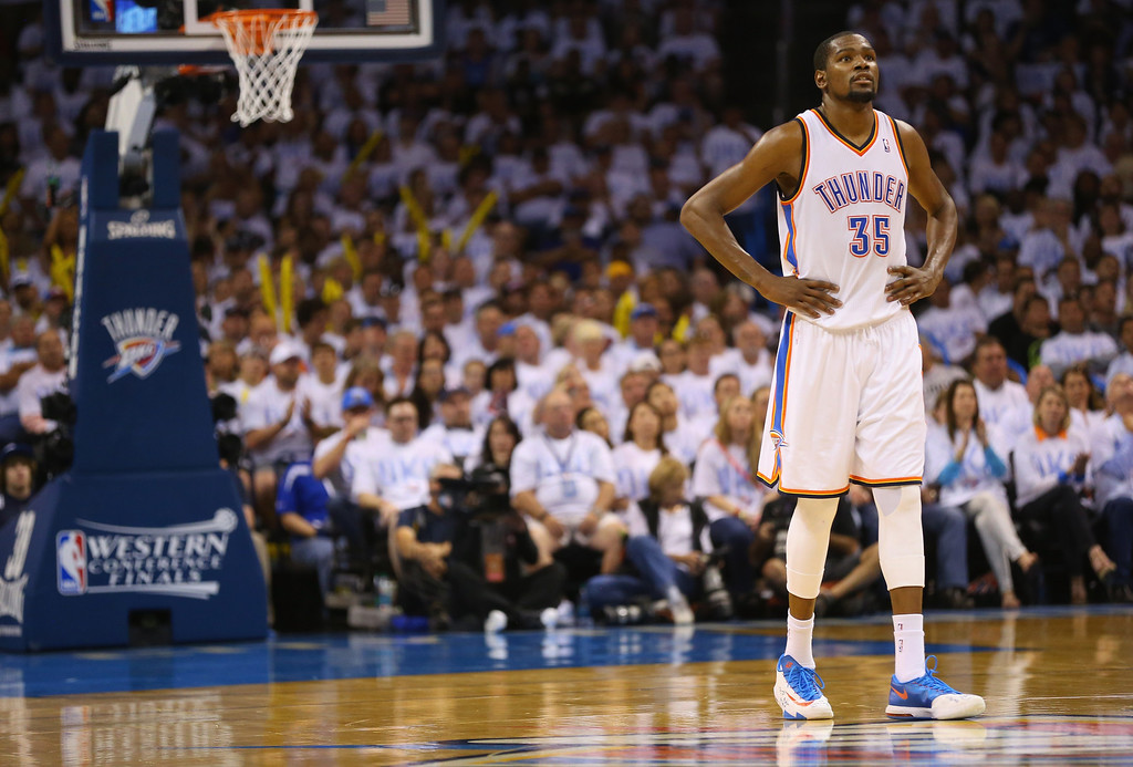 . OKLAHOMA CITY, OK - MAY 31:  Kevin Durant #35 of the Oklahoma City Thunder waits on the court in the second half against the San Antonio Spurs during Game Six of the Western Conference Finals of the 2014 NBA Playoffs at Chesapeake Energy Arena on May 31, 2014 in Oklahoma City, Oklahoma. (Photo by Ronald Martinez/Getty Images)