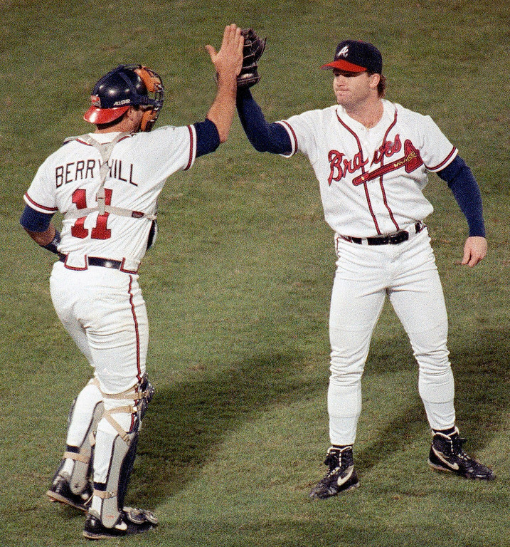 . MIKE STANTON -- Atlanta Braves reliever Mike Stanton (30) is congratulated by catcher Damon Berryhill (11) after downing the Pittsburgh Pirates 5-1 to win game one of the NLCS in Atlanta on Oct. 6, 1992. (AP Photo/Ed Reinke)