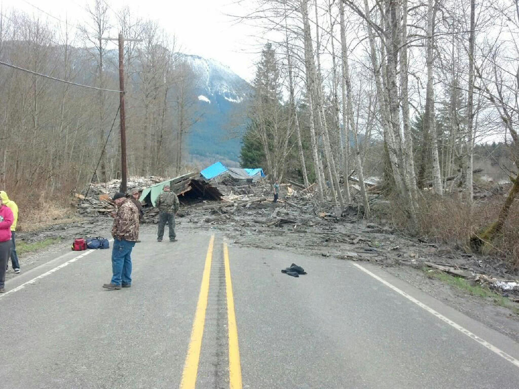 . This photo provided by the Washington State Patrol shows the aftermath of a mudslide that moved a house with people inside in Snohomish County on Saturday March 22, 2014. The Washington Department of Transportation says mud, trees and building materials are blocking both directions of State Route 530 near the town of Oso. Search and rescue operations are underway by Snohomish County crews and the Washington State Patrol. Spokesman Bart Treece of the Washington State Department of Transportation says he doesn\'t know how long the two-lane rural road will be closed. He says drivers are advised to find another way to get between Darrington and Arlington. (AP Photo/Washington State Patrol)