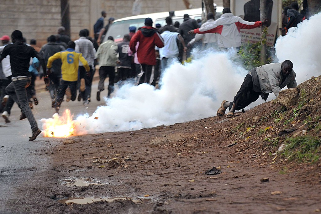 . Onlookers are teargassed by police trying to disperse idlers who had milled around a prestigious shopping mall on September 24, 2013 in Nairobi, which is the scene of a siege by Somali islamists now on its fourth day. Security forces are defusing explosive devices set up by the jihadists inside the still ongoing shopping mall siege, where extremists claim to be still holding hostages, police said on Septenber 24. Sporadic gunfire broke out again at dawn, hours after Kenyan forces had claimed to have wrested back control of the building from the fundamentalists who are said to include American nationals and a Brtitish woman. TONY KARUMBA/AFP/Getty Images