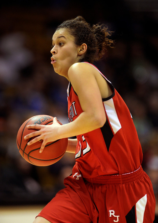. BOULDER, CO. - MARCH 16: Raiders sophomore guard Jessica Lewis moved with the ball in the second half. The Regis Jesuit High School girl\'s basketball team defeated Highlands Ranch 53-46 in the 5A championship game Saturday, March 16, 2013 at the Coors Events Center in Boulder.  (Photo By Karl Gehring/The Denver Post)