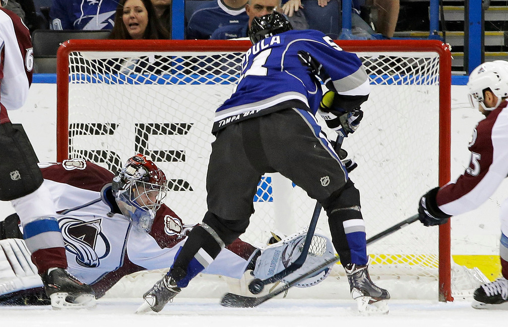 . Colorado Avalanche goalie Sami Aittokallio (30), of Finland, dives to stop a shot by Tampa Bay Lightning center Valtteri Filppula (51), also of Finland, during the first period of an NHL hockey game Saturday, Jan. 25, 2014, in Tampa, Fla. (AP Photo/Chris O\'Meara)