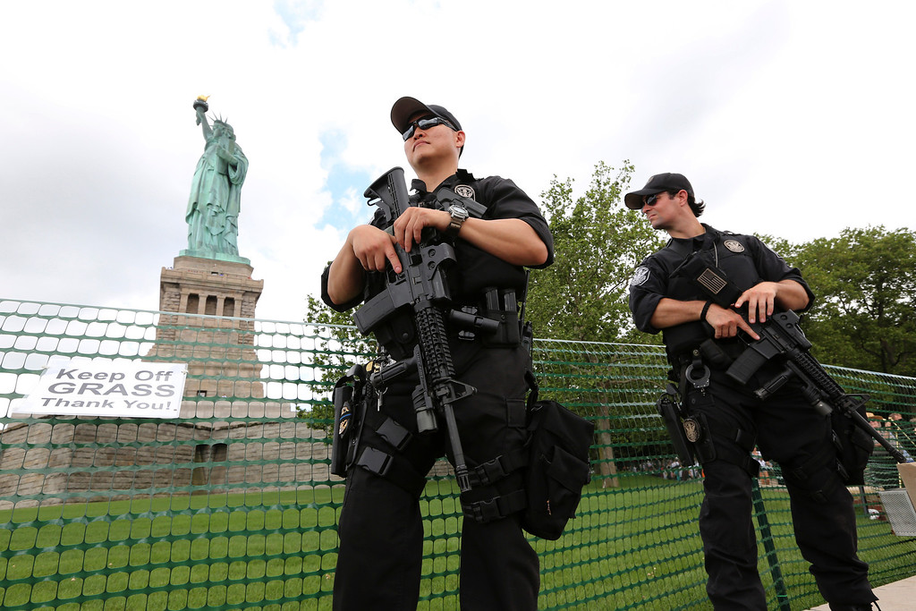 . United States Park police swat team members stand guard at the Statue of Liberty, Thursday, July 4, 2013 at  in New York. The Statue of Liberty finally reopened on the Fourth of July months after Superstorm Sandy swamped its little island in New York Harbor as Americans across the country marked the holiday with fireworks and barbecues. (AP Photo/Mary Altaffer)