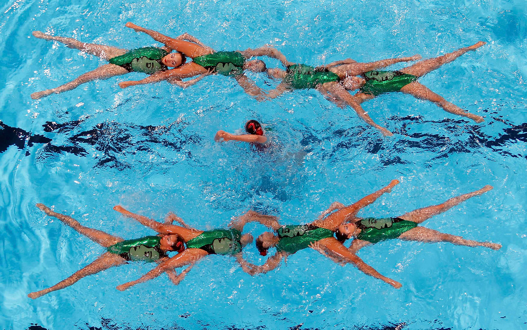 . Japan\'s team perform in the synchronised swimming free combination routine preliminaries during the World Swimming Championships at the Sant Jordi arena in Barcelona July 21, 2013.    REUTERS/Albert Gea