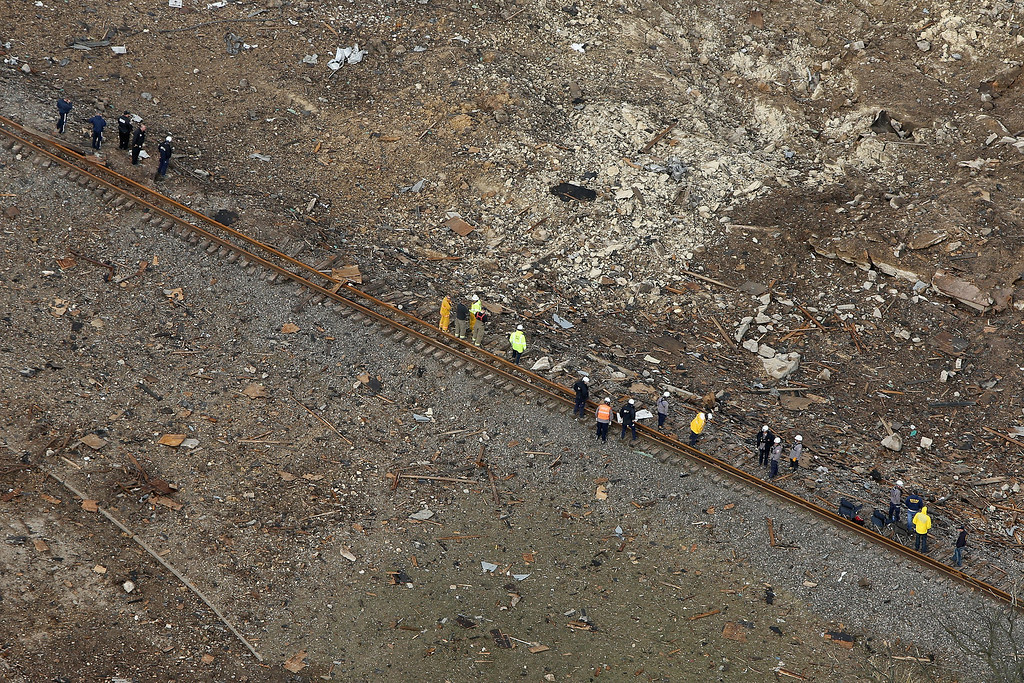 . WEST, TX - APRIL 18:  An emergency repair team inspects the damaged railroad tracks that ran next to the West Fertilizer Company, which was destroyed by an explosion a day earlier on April 18, 2013 in West, Texas. According to West Mayor Tommy Muska, around 14 people, including 10 first responders, were killed and more than 150 people were injured when the fertilizer company caught fire and exploded, leaving damaged buildings for blocks in every direction.  (Photo by Chip Somodevilla/Getty Images)