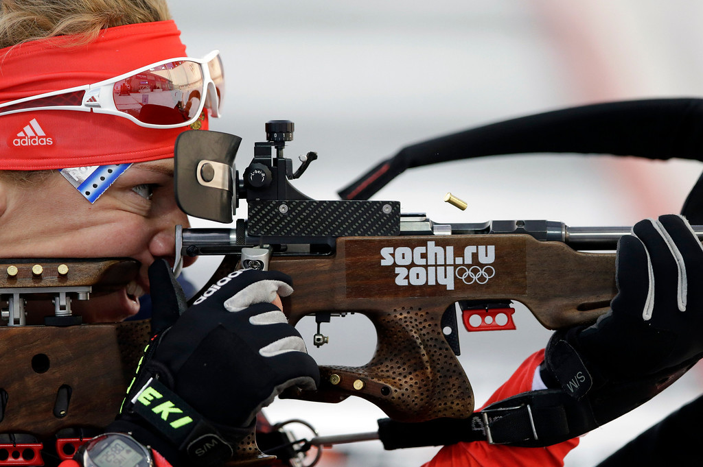 . Russia\'s Olga Zaitseva shoots during the women\'s biathlon 15k individual race, at the 2014 Winter Olympics, Friday, Feb. 14, 2014, in Krasnaya Polyana, Russia. (AP Photo/Lee Jin-man)