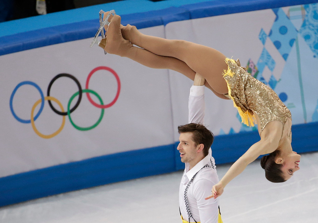 Description of . Stefania Berton and Ondrej Hotarek of Italy compete in the pairs short program figure skating competition at the Iceberg Skating Palace during the 2014 Winter Olympics, Tuesday, Feb. 11, 2014, in Sochi, Russia. (AP Photo/Bernat Armangue)