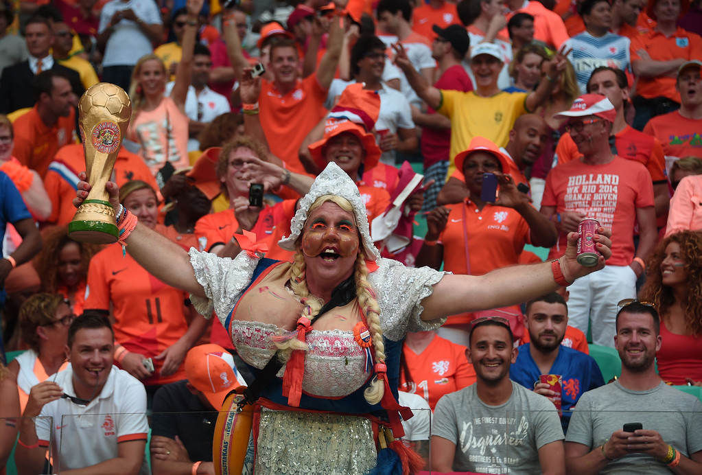 . Fans of the Netherlands react during a Group B football match between Spain and the Netherlands at the Fonte Nova Arena in Salvador during the 2014 FIFA World Cup on June 13, 2014. DAMIEN MEYER/AFP/Getty Images