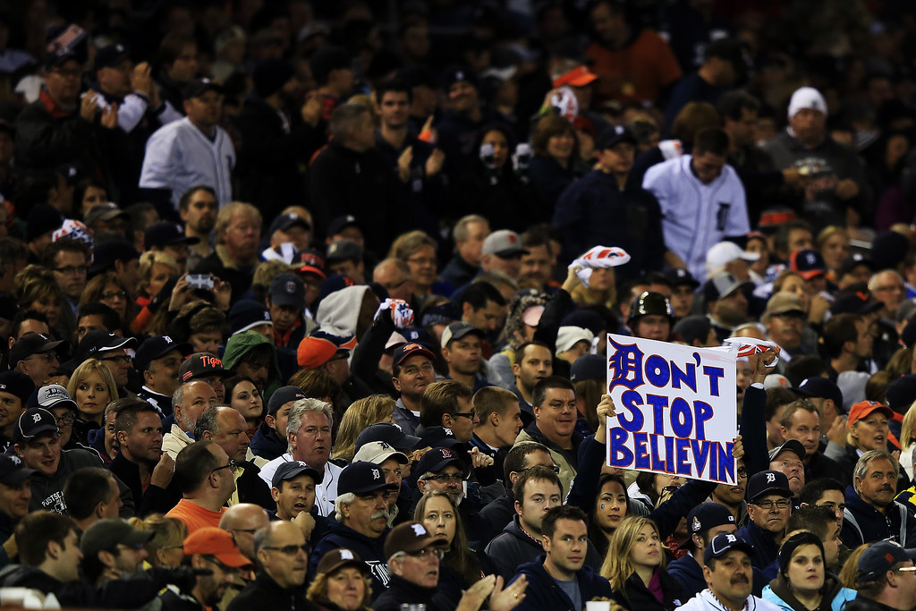 . Detroit Tigers fans hold up signs during Game Four of the American League Championship Series against the Boston Red Sox at Comerica Park on October 16, 2013 in Detroit, Michigan.  (Photo by Jamie Squire/Getty Images)