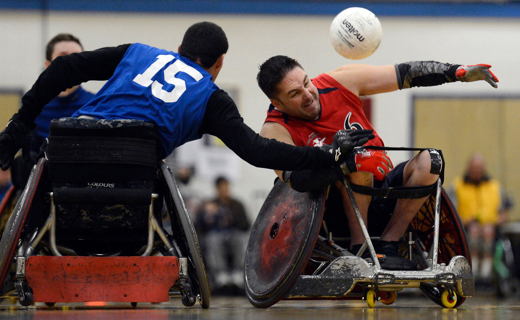 . DENVER, CO. - FEBRUARY 10: Garrett Obsorne (6) of the Denver Harlequins can\'t gain control of the ball as Jack Hermosillo defends on the play during the Wheelchair Rugby Tournament February 10, 2013 at Englewood High School.  The Mile High Mayhem was put on by Craig Hospital and city of Englewood.(Photo By John Leyba/The Denver Post)