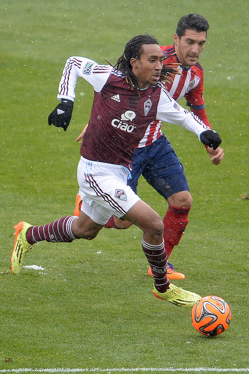 . Marlon Hairston (94) of Colorado Rapids is defended by Martin Rivero (5) of Chivas USA during the first half. The Colorado Rapids host Chivas U.S.A. on Sunday, May 11, 2014. (Photo by AAron Ontiveroz/The Denver Post)