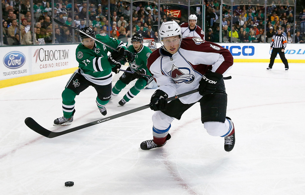 . Erik Johnson #6 of the Colorado Avalanche controls the puck against Ray Whitney #13 of the Dallas Stars and Erik Cole #72 of the Dallas Stars in the first period at American Airlines Center on January 27, 2014 in Dallas, Texas.  (Photo by Tom Pennington/Getty Images)