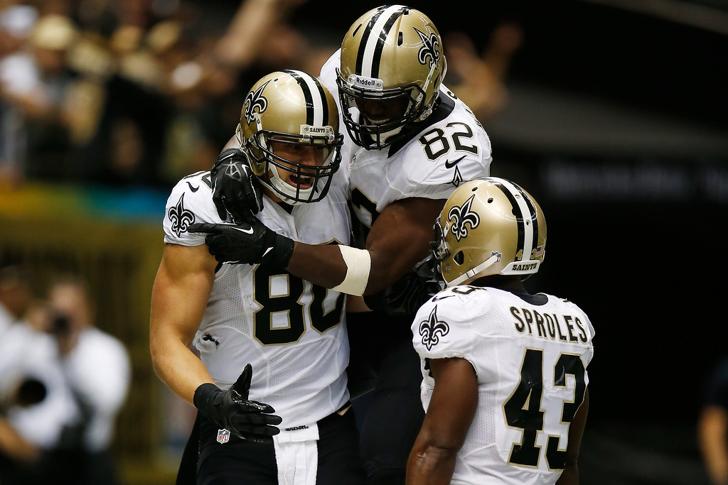 . Jimmy Graham #80 of the New Orleans Saints scores a touchdown over  Chris Clemons #30 of the Miami Dolphins at the Mercedes-Benz Superdome on September 30, 2013 in New Orleans, Louisiana.  (Photo by Chris Graythen/Getty Images)
