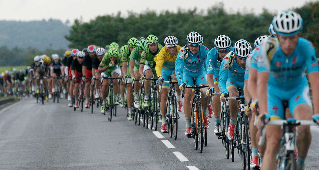 . The pack rides during the nineteenth stage of the Tour de France cycling race over 208.5 kilometers (129.6 miles) with start in Maubourguet and finish in Bergerac, France, Friday, July 25, 2014. (AP Photo/Christophe Ena)