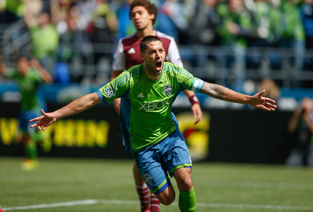 . Clint Dempsey #2 of the Seattle Sounders FC reacts after scoring his second goal  against the Colorado Rapids at CenturyLink Field on April 26, 2014 in Seattle, Washington. The Sounders defeated the Rapids 4-1.  (Photo by Otto Greule Jr/Getty Images)