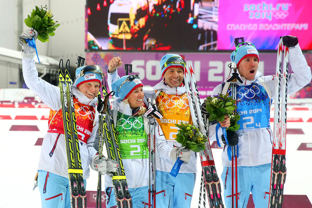 . (L-R) Gold medalists Tora Berger of Norway, Tiril Eckhoff of Norway, Ole Einar Bjoerndalen of Norway and Emil Hegle Svendsen of Norway celebrate during the flower ceremony for the 2 x 6 km Women + 2 x 7 km Men Mixed Relay during day 12 of the Sochi 2014 Winter Olympics at Laura Cross-country Ski & Biathlon Center on February 19, 2014 in Sochi, Russia.  (Photo by Julian Finney/Getty Images)