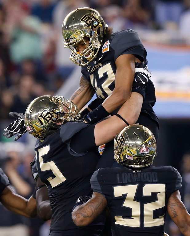 . Baylor wide receiver Levi Norwood (42) celebrates his touchdown with teammates Shock Linwood (32) and Troy Baker during the first half of the Fiesta Bowl NCAA college football game against Central Florida, Wednesday, Jan. 1, 2014, in Glendale, Ariz. (AP Photo/Ross D. Franklin)