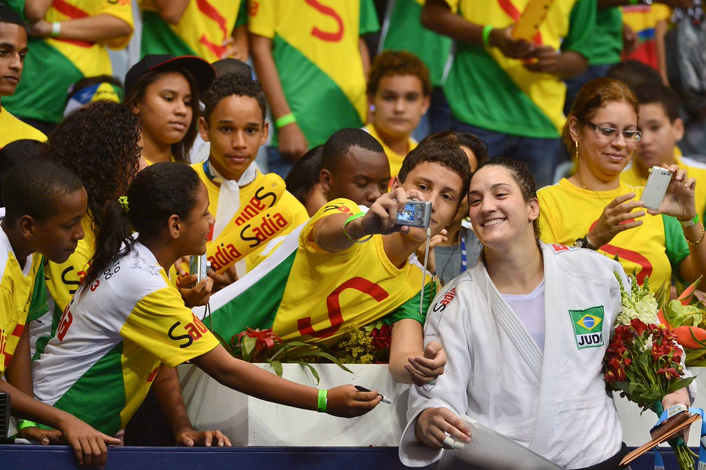 . Brazilian bronze medallist Mayra Aguiar poses with fans after the medal ceremony for the women\'s -78kg category, during the IJF World Judo Championship, in Rio de Janeiro, Brazil, on August 30, 2013.  YASUYOSHI CHIBA/AFP/Getty Images