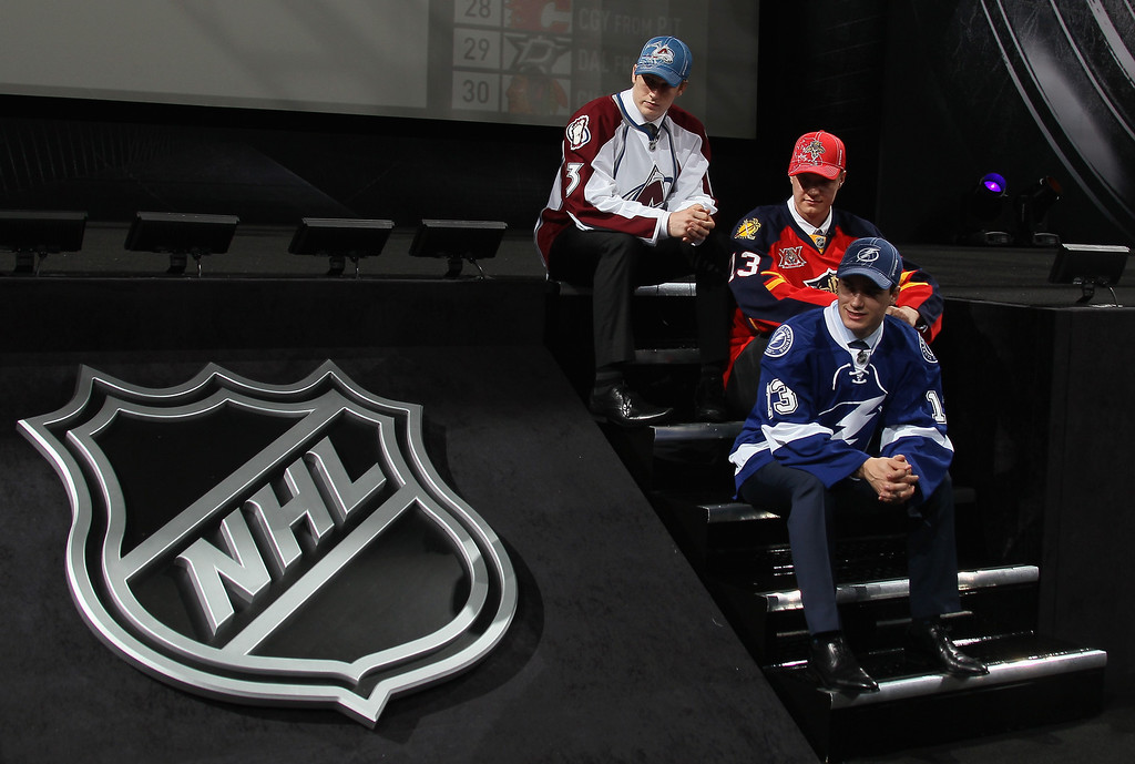 . Number three over all Jonathan Drouin (Bottom) of Tampa Bay Lightning, number one over all Nathan Mackinnon (Top) of the Colorado Avalanche and number two over all Aleksander Barkov (Middle) of the Florida Panthers pose during the 2013 NHL Draft at the Prudential Center on June 30, 2013 in Newark, New Jersey.  (Photo by Bruce Bennett/Getty Images)