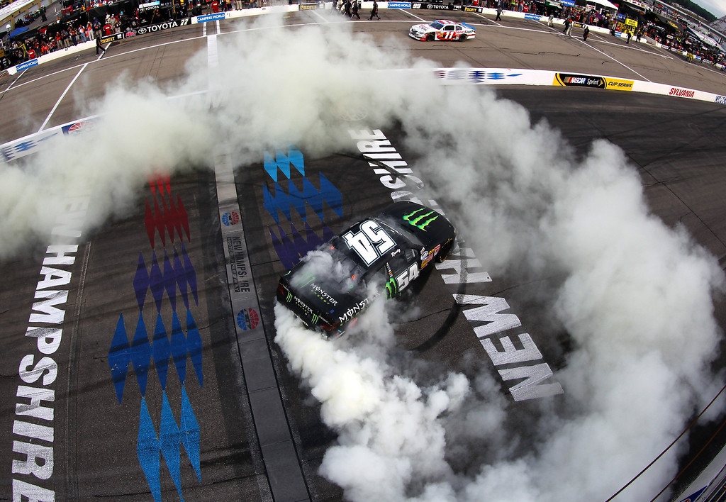 . Kyle Busch, driver of the #54 Monster Energy Toyota, celebrates with a burnout after winning the NASCAR Nationwide Series CNBC Prime\'s The Profit 200 at New Hampshire Motor Speedway on July 13, 2013 in Loudon, New Hampshire.  (Photo by Jonathan Ferrey/NASCAR via Getty Images)