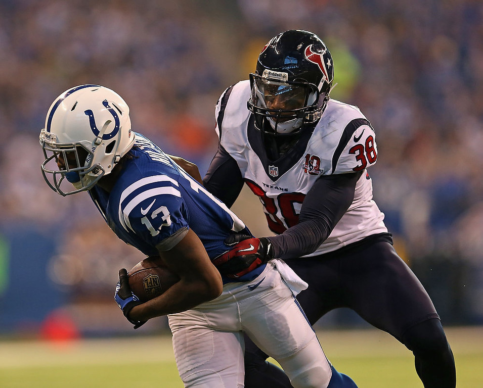 . T.Y. Hilton #13 of the Indianapolis Colts breaks away from Danieal Manning #38 of the Houston Texans at Lucas Oil Stadium on December 30, 2012 in Indianapolis, Indiana. (Photo by Jonathan Daniel/Getty Images)