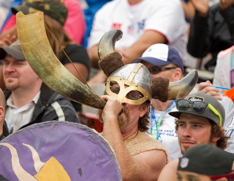 . A Minnesota Vikings fan is dress up like a viking blows his horn during the second quarter of the NFL Pro Bowl football game in Honolulu, Sunday, Jan. 27, 2013. (AP Photo/Eugene Tanner)