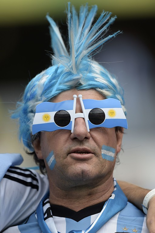 . An Argentina\'s fan poses before the Group F football match between Nigeria and Argentina at the Beira-Rio Stadium in Porto Alegre during the 2014 FIFA World Cup on June 25, 2014.  AFP PHOTO / JUAN  MABROMATA/AFP/Getty Images