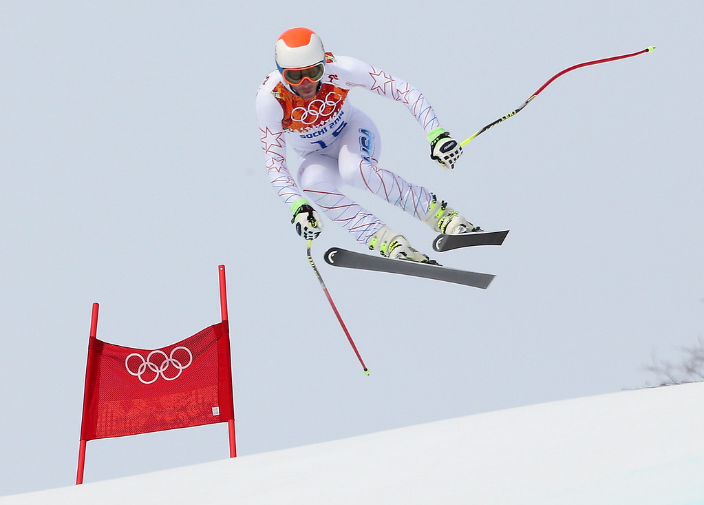 . United States\' Bode Miller jumps during the men\'s downhill at the Sochi 2014 Winter Olympics, Sunday, Feb. 9, 2014, in Krasnaya Polyana, Russia.(AP Photo/Luca Bruno)