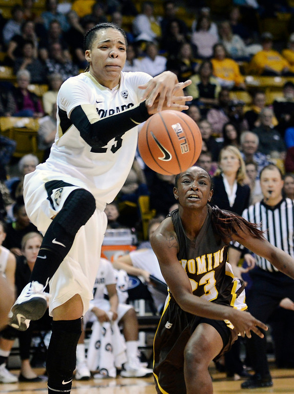 . Colorado\'s Chucky Jeffery, top left, has the ball knocked out of her hands by Wyoming\'s Chelan Landry during their NCAA college basketball game, Wednesday, Nov. 28, 2012, in Boulder, Colo. Colorado won 68-59. (AP Photo/The Daily Camera, Jeremy Papasso)