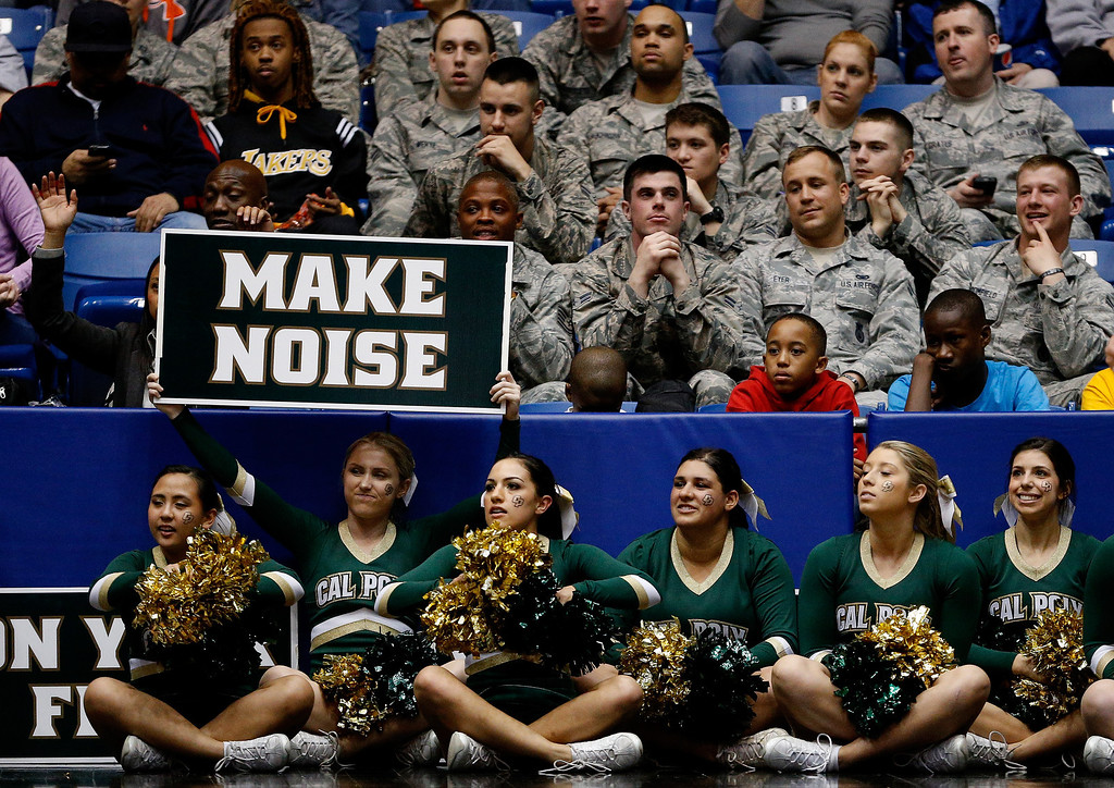 . DAYTON, OH - MARCH 19: The Cal Poly Mustangs cheerleaders look on during the first round of the 2014 NCAA Men\'s Basketball Tournament against the Texas Southern Tigers at UD Arena on March 19, 2014 in Dayton, Ohio.  (Photo by Gregory Shamus/Getty Images)