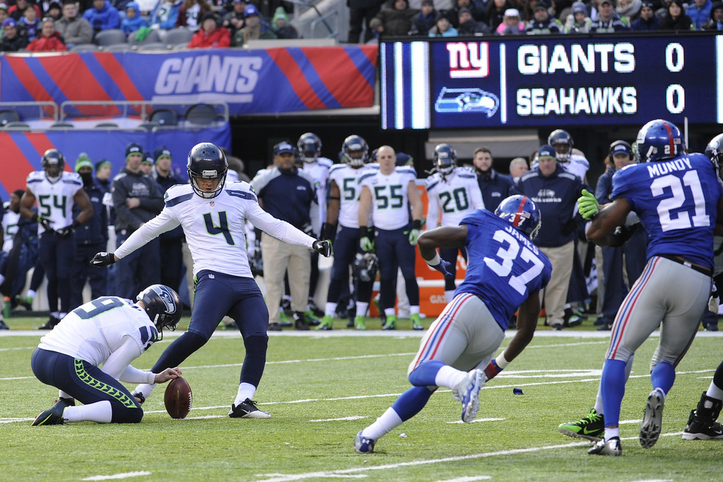 . Seattle Seahawks kicker Steven Hauschka (4), with Jon Ryan holding, kicks a field goal against the New York Giants during the first half of an NFL football game, Sunday, Dec. 15, 2013, in East Rutherford, N.J. (AP Photo/Bill Kostroun)