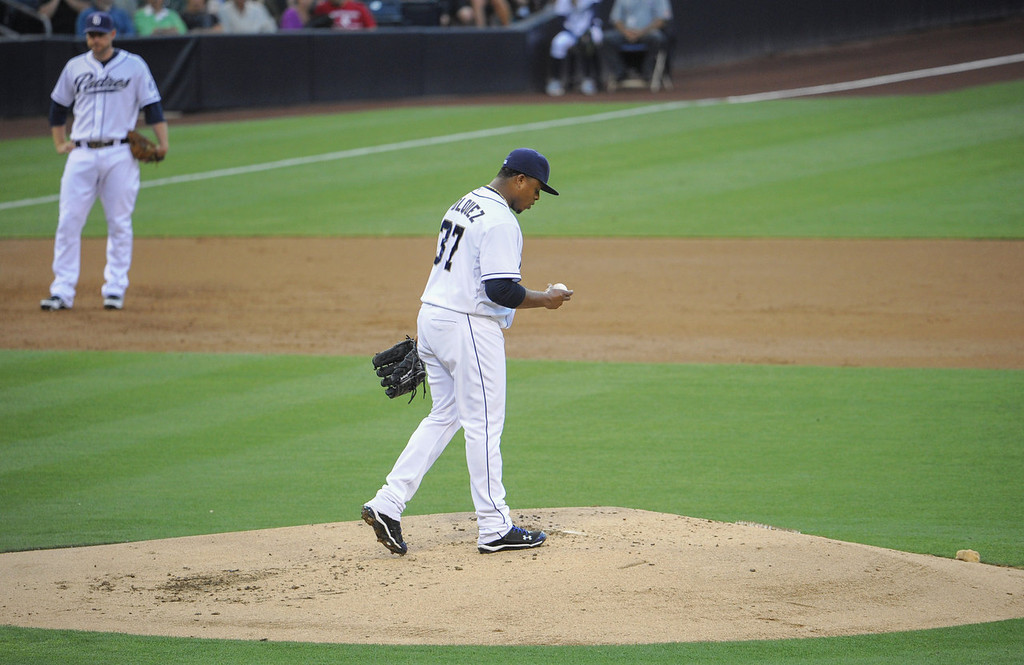 . Edinson Volquez #37 of the San Diego Padres walks back to the mound after allowing a hit during the second inning of a baseball game against the Colorado Rockies at Petco Park on July 8, 2013 in San Diego, California.  (Photo by Denis Poroy/Getty Images)