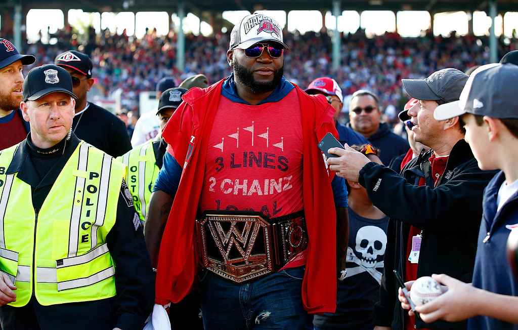 . BOSTON, MA - NOVEMBER 02: David Ortiz #34 of the Boston Red Sox walks to his float while wearing a wrestling belt during the World Series victory parade at Fenway Park on November 2, 2013 in Boston, Massachusetts.  (Photo by Jared Wickerham/Getty Images)