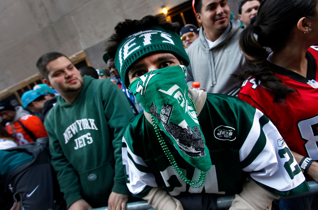 . New York Jets fan Eric Rosen, of the Staten Island borough of New York, waits in line outside Radio City Music Hall before the first round of the NFL football draft on Thursday, April 25, 2013, in New York. (AP Photo/Jason DeCrow)