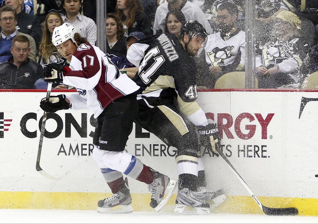 . Steve Downie #17 of the Colorado Avalanche and Robert Bortuzzo #41 of the Pittsburgh Penguins battle along the boards during the game at Consol Energy Center on October 21, 2013 in Pittsburgh, Pennsylvania.  (Photo by Justin K. Aller/Getty Images)