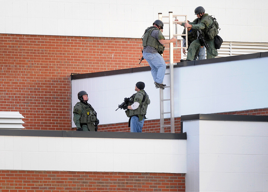 . CENTENNIAL, CO. - DECEMBER 13: Arapahoe County SWAT team members searched the roof of Arapahoe High School Friday afternoon, December 13, 2013. A shooting inside the school sent hundreds of students rushing for safety. Photo By Karl Gehring/The Denver Post