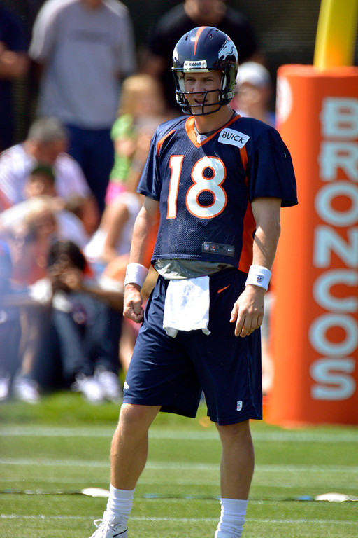 . Denver Broncos QB Peyton Manning (18) looks on during training camp July 26, 2013 at Dove Valley. (Photo By John Leyba/The Denver Post)