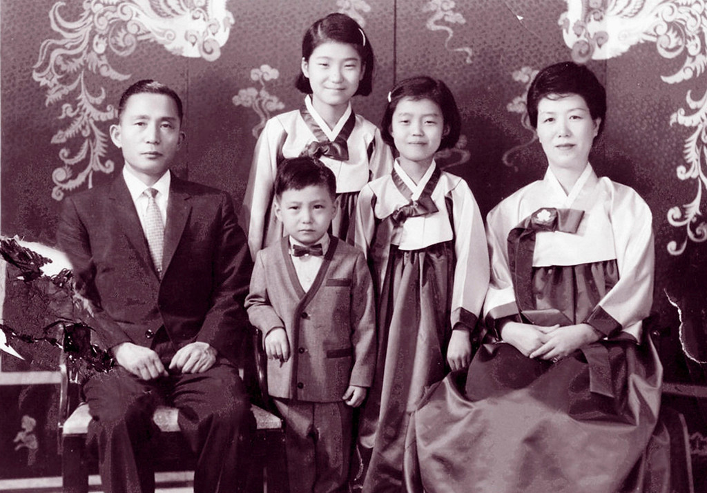 . Park Geun-hye (top C) is seen with her father Park Chung-hee (L) and mother Yuk Young-soo (R) in this undated family photo released by Yonhap in Seoul February 24, 2013.  REUTERS/Yonhap/Files