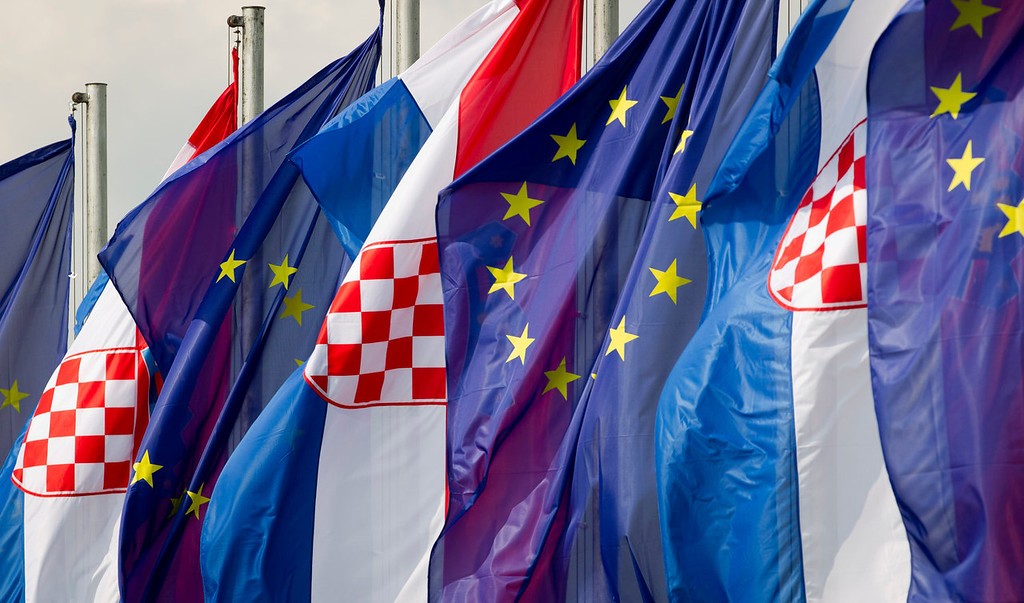 . Croatian and the EU flags are seen at an intersection in Zagreb, Croatia, Saturday, June 29, 2013. Croatia is to join the European Union on July 1, 2013. (AP Photo/Darko Bandic)