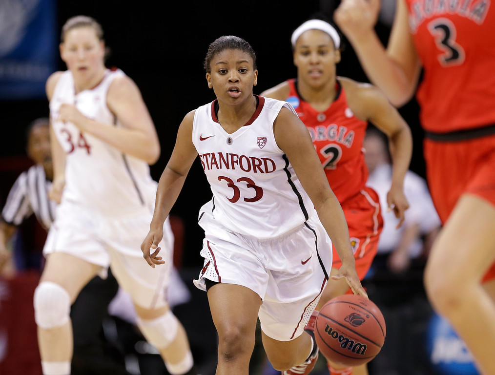 . Stanford\'s Amber Orrange (33) brings the ball up against Georgia in the first half of a regional semifinal in the NCAA women\'s college basketball tournament Saturday, March 30, 2013, in Spokane, Wash. (AP Photo/Elaine Thompson)